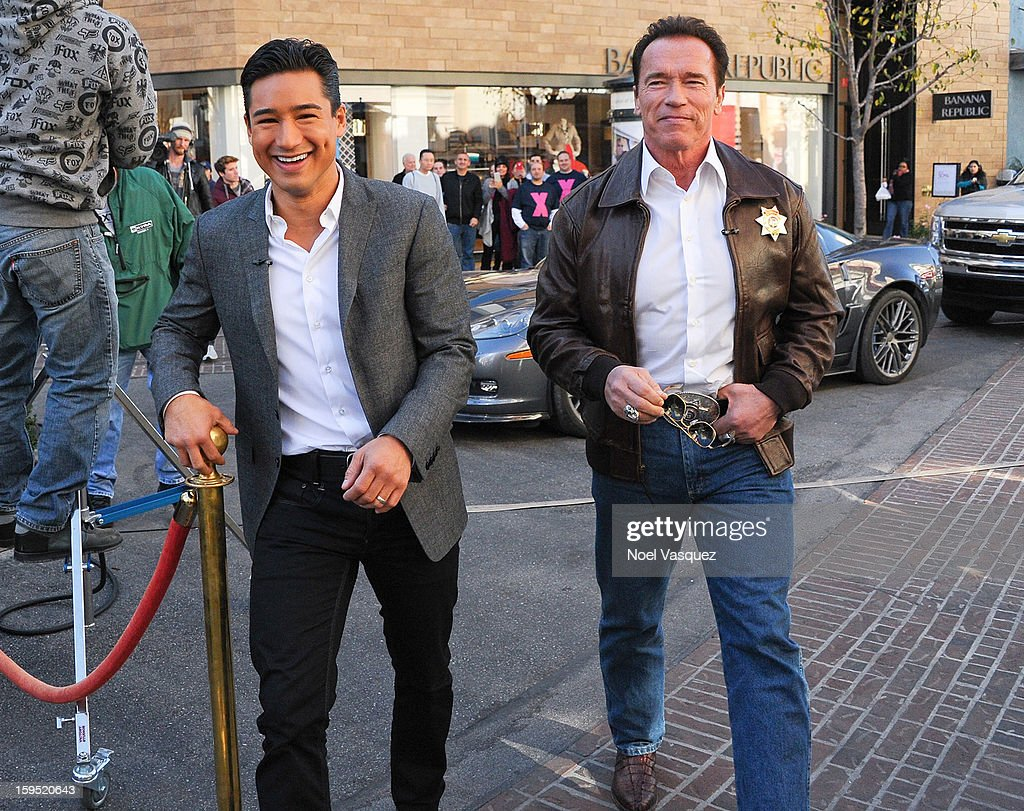<a gi-track='captionPersonalityLinkClicked' href=/galleries/search?phrase=Mario+Lopez&family=editorial&specificpeople=235992 ng-click='$event.stopPropagation()'>Mario Lopez</a> and <a gi-track='captionPersonalityLinkClicked' href=/galleries/search?phrase=Arnold+Schwarzenegger&family=editorial&specificpeople=156406 ng-click='$event.stopPropagation()'>Arnold Schwarzenegger</a> (R) visit Extra at The Grove on January 14, 2013 in Los Angeles, California.