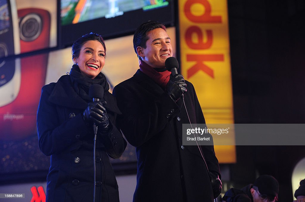 Mario Lopez and Courtney Lopez, co-hosts of the NIVEA Kiss Stage in Times Square, help others prepare for the 'Kiss of the Year'on New YearÕs Eve 2013 on December 31, 2012 in New York City.