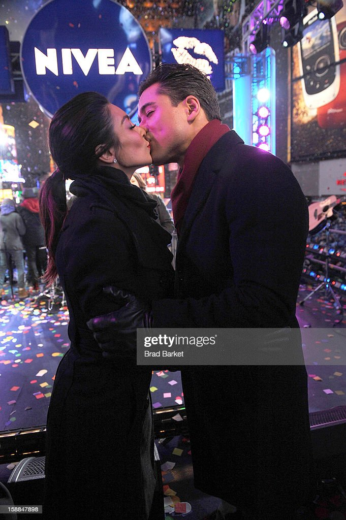 Mario Lopez and Courtney Lopez, co-hosts of the NIVEA Kiss Stage in Times Square, share the 'Kiss of the Year'on New YearÕs Eve 2013 in New York City.