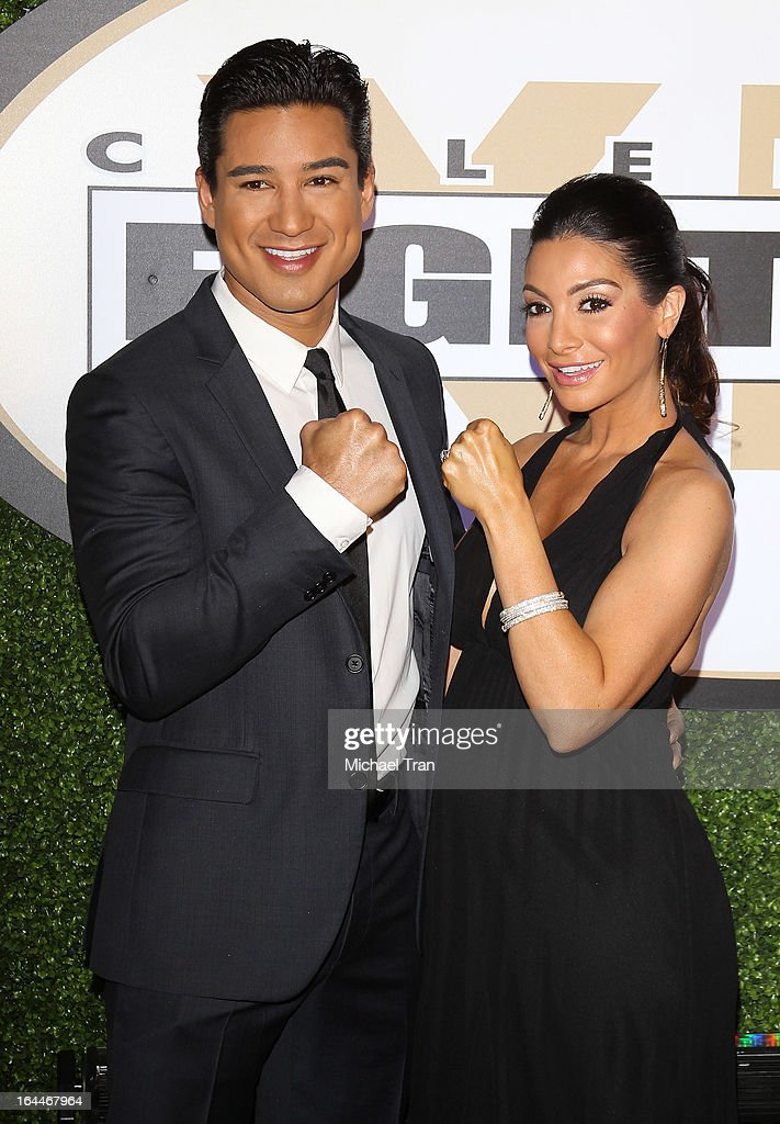 Mario Lopez (L) and Courtney Mazza arrive at Celebrity Fight Night XIX held at JW Marriott Desert Ridge Resort & Spa on March 23, 2013 in Phoenix, Arizona.