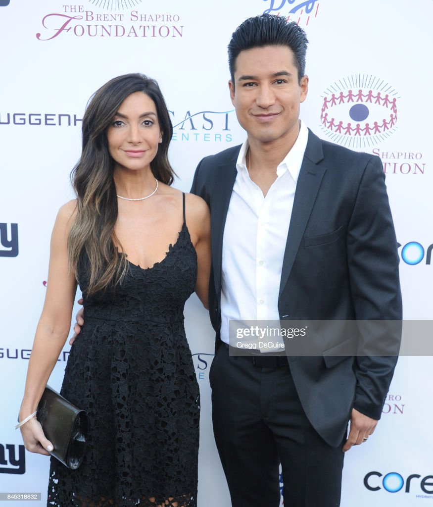 Mario Lopez and Courtney Mazza arrive at the annual Brent Shapiro Foundation For Alcohol and Drug Prevention Summer Spectacular at a Private Residence on September 9, 2017 in Beverly Hills, California.
