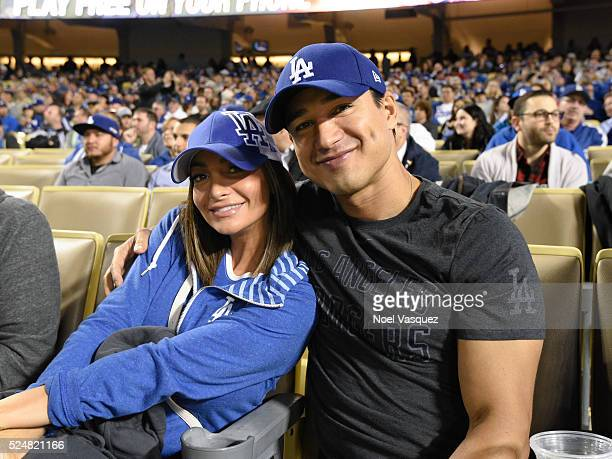 Mario Lopez and Courtney Mazza attend a baseball game between the Miami Marlins and the Los Angeles Dodgers at Dodger Stadium on April 26 2016 in Los...