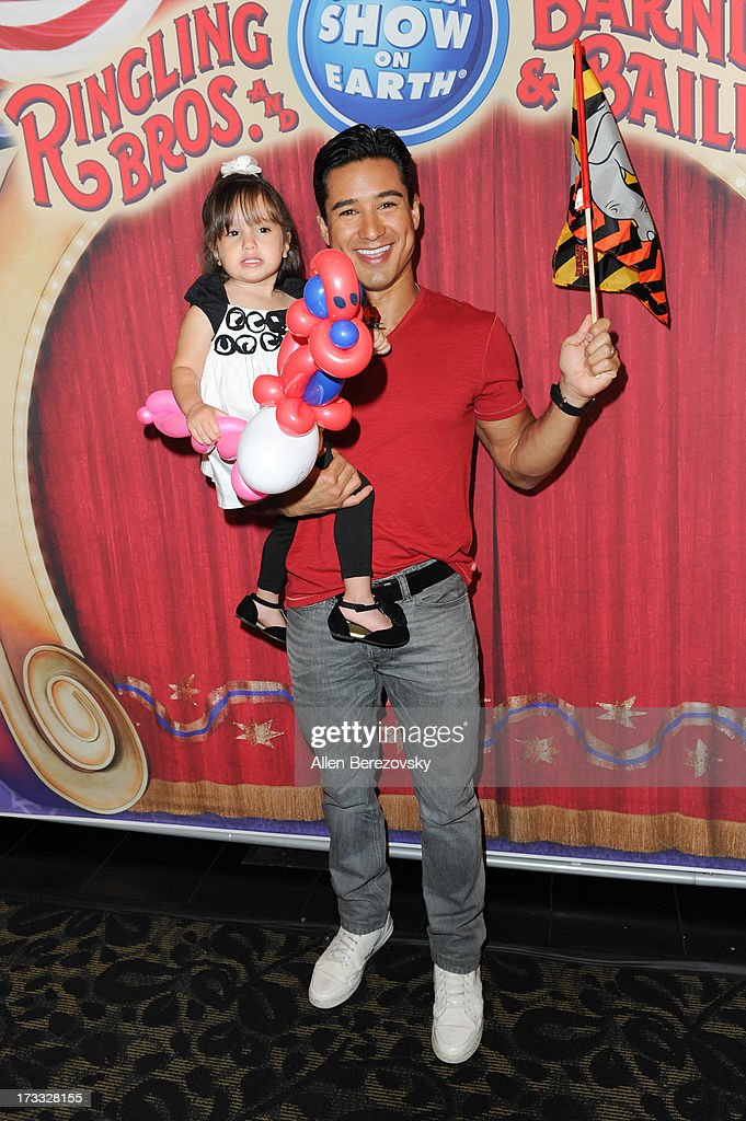 <a gi-track='captionPersonalityLinkClicked' href=/galleries/search?phrase=Mario+Lopez&family=editorial&specificpeople=235992 ng-click='$event.stopPropagation()'>Mario Lopez</a> and daughter Gia Lopez attend the celebrity premiere of Ringling Bros. and Barnum & Bailey's 'Built To Amaze!' tour at Staples Center on July 11, 2013 in Los Angeles, California.