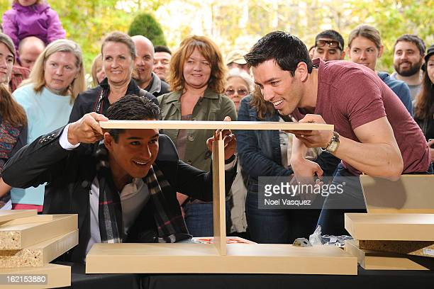 Mario Lopez and Drew Scott build a bookshelf at Extra at The Grove on February 19 2013 in Los Angeles California