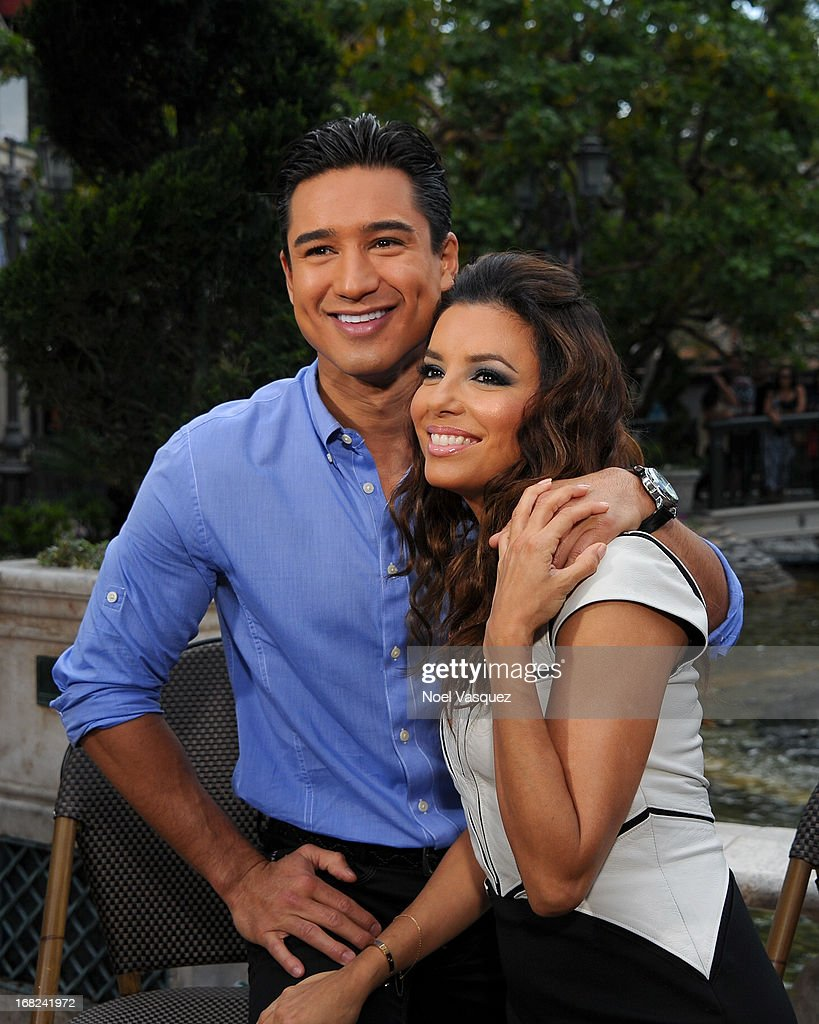 <a gi-track='captionPersonalityLinkClicked' href=/galleries/search?phrase=Mario+Lopez&family=editorial&specificpeople=235992 ng-click='$event.stopPropagation()'>Mario Lopez</a> (L) and <a gi-track='captionPersonalityLinkClicked' href=/galleries/search?phrase=Eva+Longoria&family=editorial&specificpeople=202082 ng-click='$event.stopPropagation()'>Eva Longoria</a> visit 'Extra' at The Grove on May 7, 2013 in Los Angeles, California.