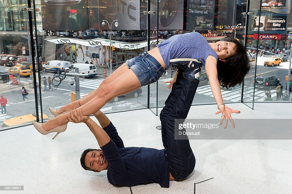 <a gi-track='captionPersonalityLinkClicked' href=/galleries/search?phrase=Mario+Lopez&family=editorial&specificpeople=235992 ng-click='$event.stopPropagation()'>Mario Lopez</a> and Hilaria Baldwin host 'Extra' at their New York studios at H&M in Times Square on April 22, 2014 in New York City.