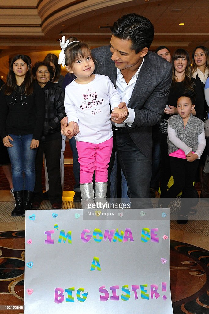 Mario Lopez and his daughter Gia announce his new baby at Extra at The Grove on February 19, 2013 in Los Angeles, California.