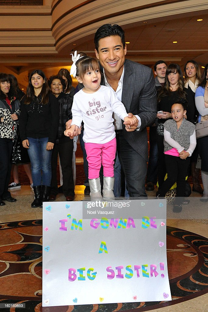 <a gi-track='captionPersonalityLinkClicked' href=/galleries/search?phrase=Mario+Lopez&family=editorial&specificpeople=235992 ng-click='$event.stopPropagation()'>Mario Lopez</a> and his daughter Gia announce his new baby at Extra at The Grove on February 19, 2013 in Los Angeles, California.