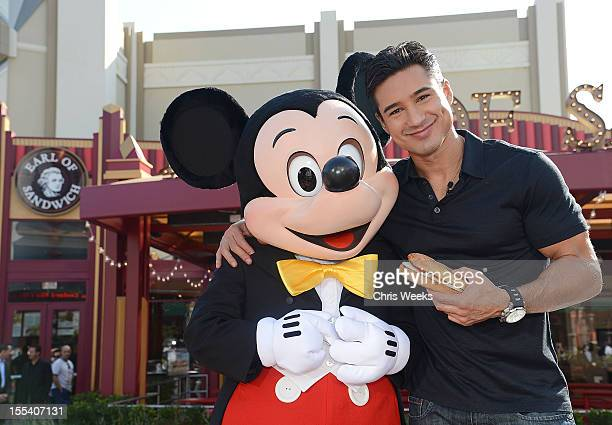 Mario Lopez and Mickey Mouse attend the opening of Earl of Sandwich at Downtown Disney District at Disneyland Resort on November 3 2012 in Anaheim...