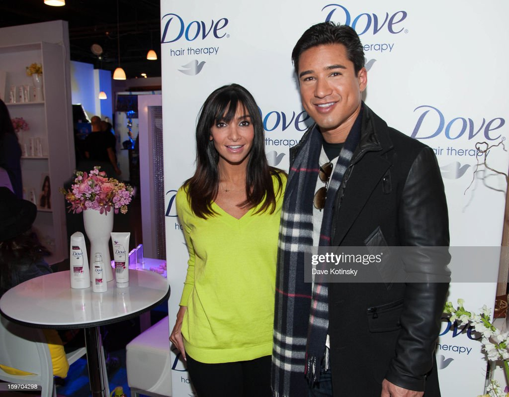 Mario Lopez (R) and wife Courtney Lopez stopped by the Dove® Color Care Salon in Park City (to learn about the new Dove® Color Care Shampoo and Conditioner) on January 18, 2013 in Park City, Utah.