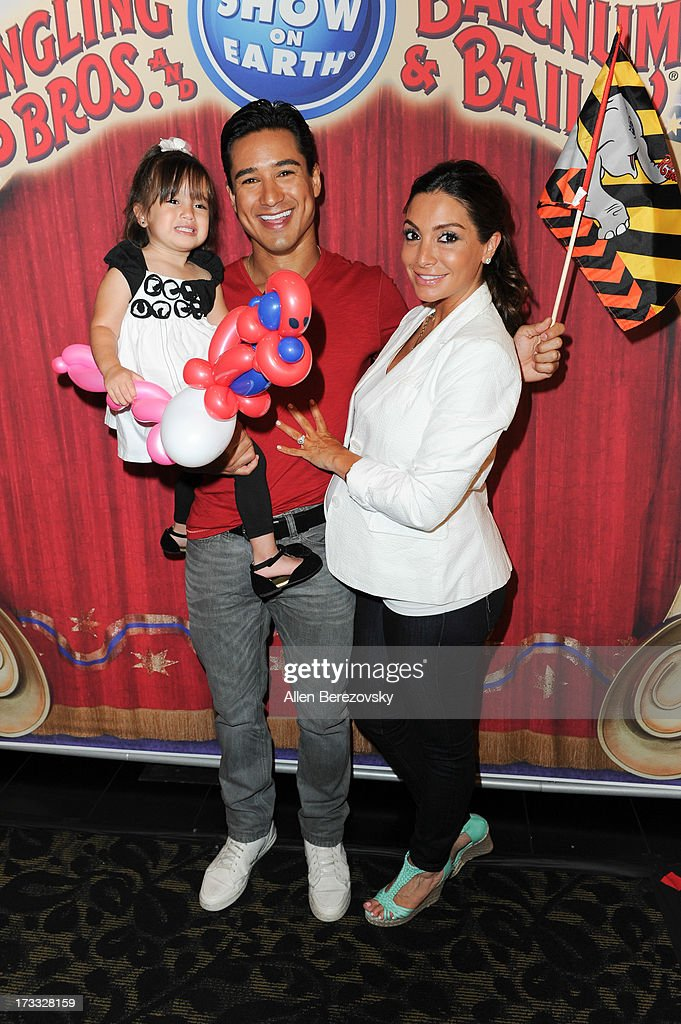 <a gi-track='captionPersonalityLinkClicked' href=/galleries/search?phrase=Mario+Lopez&family=editorial&specificpeople=235992 ng-click='$event.stopPropagation()'>Mario Lopez</a>, <a gi-track='captionPersonalityLinkClicked' href=/galleries/search?phrase=Courtney+Mazza&family=editorial&specificpeople=5650960 ng-click='$event.stopPropagation()'>Courtney Mazza</a> and daughter Gia Lopez attend the celebrity premiere of Ringling Bros. and Barnum & Bailey's 'Built To Amaze!' tour at Staples Center on July 11, 2013 in Los Angeles, California.