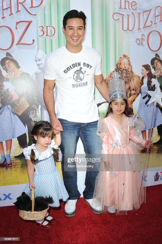 <a gi-track='captionPersonalityLinkClicked' href=/galleries/search?phrase=Mario+Lopez&family=editorial&specificpeople=235992 ng-click='$event.stopPropagation()'>Mario Lopez</a>, daughter Gia Francesca Lopez (L) and his niece arrive at the world premiere of 'The Wizard Of Oz 3D' and grand opening of the new TCL Chinese Theatre IMAX at TCL Chinese Theatre on September 15, 2013 in Hollywood, California.