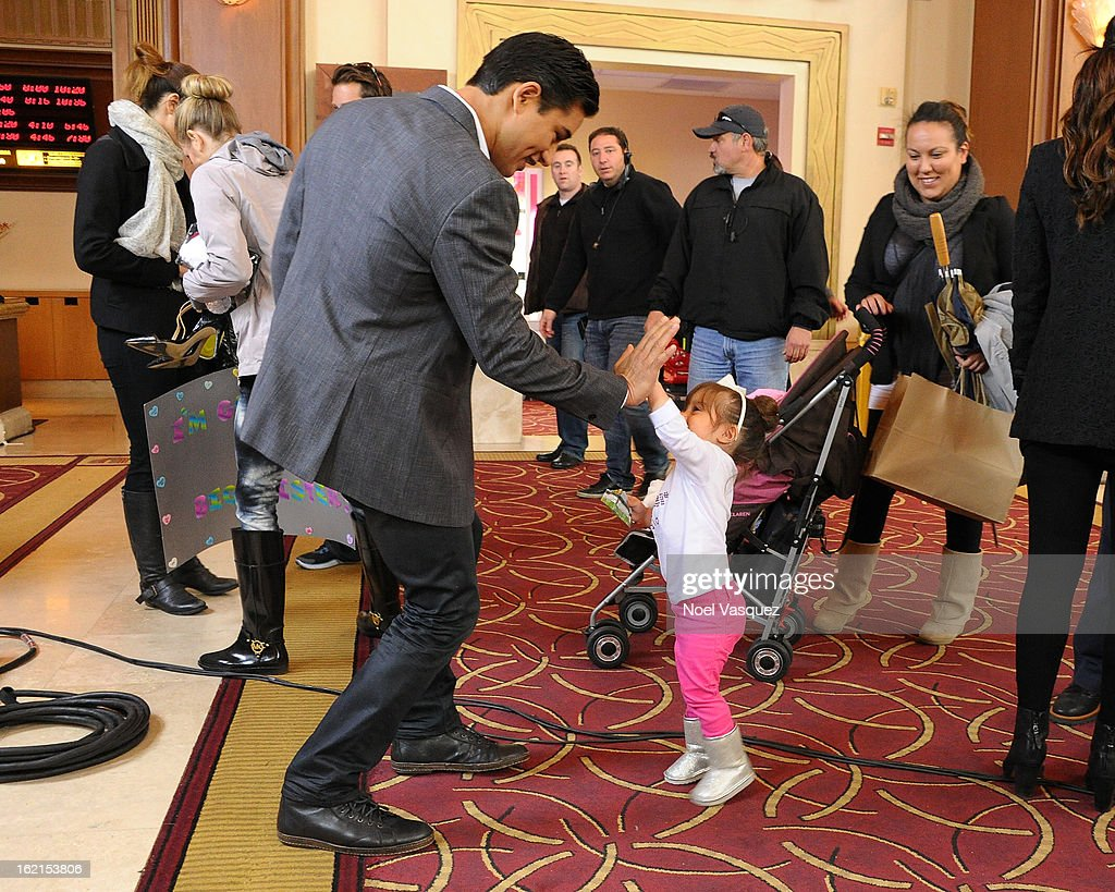 <a gi-track='captionPersonalityLinkClicked' href=/galleries/search?phrase=Mario+Lopez&family=editorial&specificpeople=235992 ng-click='$event.stopPropagation()'>Mario Lopez</a> gives his daughter Gia a high five at Extra at The Grove on February 19, 2013 in Los Angeles, California.