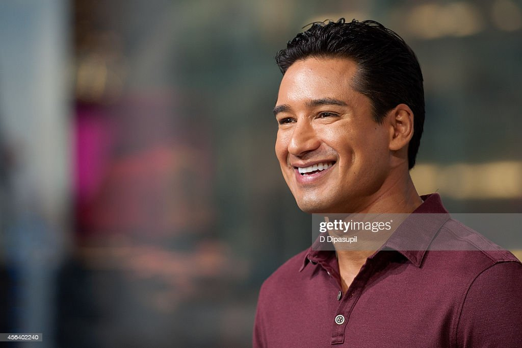 Mario Lopez hosts 'Extra' at their New York studios at HM in Times Square on September 30 2014 in New York City