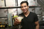 Mario Lopez mixes Margaritas on Jet Blue flight during the 'Extra' takes Mario Lopez and cast of 'A Chorus Line' to LA on April 20 2008 in New York...
