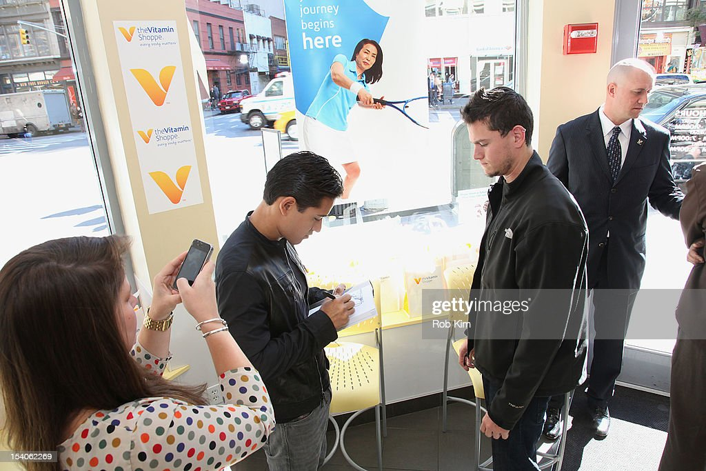 Mario Lopez signs a book for a fan at 2012 National Share The Health Event at The Vitamin Shop on October 13, 2012 in New York City.