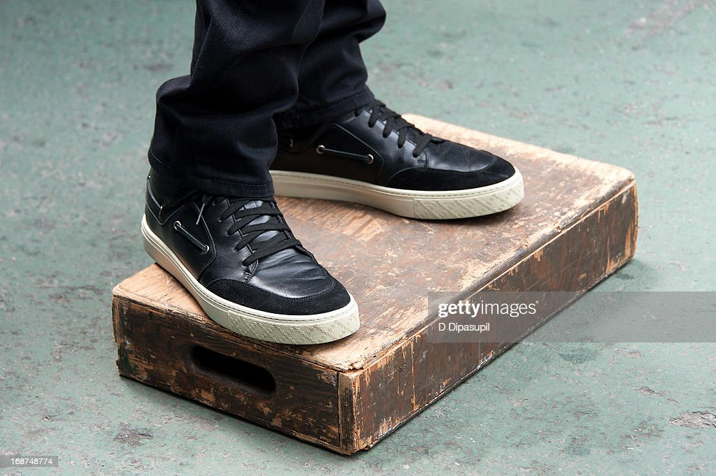 Mario Lopez (shoe detail) tapes 'Extra' in Times Square on May 14, 2013 in New York City.