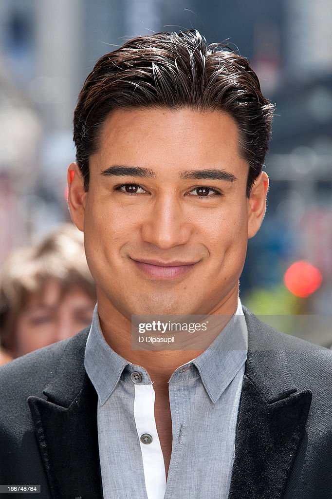 <a gi-track='captionPersonalityLinkClicked' href=/galleries/search?phrase=Mario+Lopez&family=editorial&specificpeople=235992 ng-click='$event.stopPropagation()'>Mario Lopez</a> tapes 'Extra' in Times Square on May 14, 2013 in New York City.