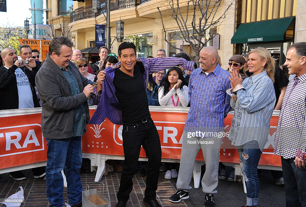 Mario Lopez tries on clothes with Eric Stonestreet at Extra at The Grove on January 31, 2013 in Los Angeles, California.
