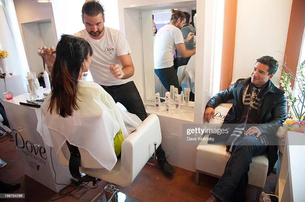 Mario Lopez watches his wife Courtney at the Dove® Color Care Salon in Park City as she get tips for keeping her hair vibrant from celebrity stylist Matt Fugate (using the new Dove® Color Care Shampoo and Conditioner)on January 18, 2013 in Park City, Utah.