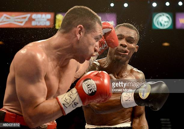 Mario Lozano hits Jermell Charlo during their junior welterweight fight at the MGM Grand Garden Arena on December 13 2014 in Las Vegas Nevada Charlo...