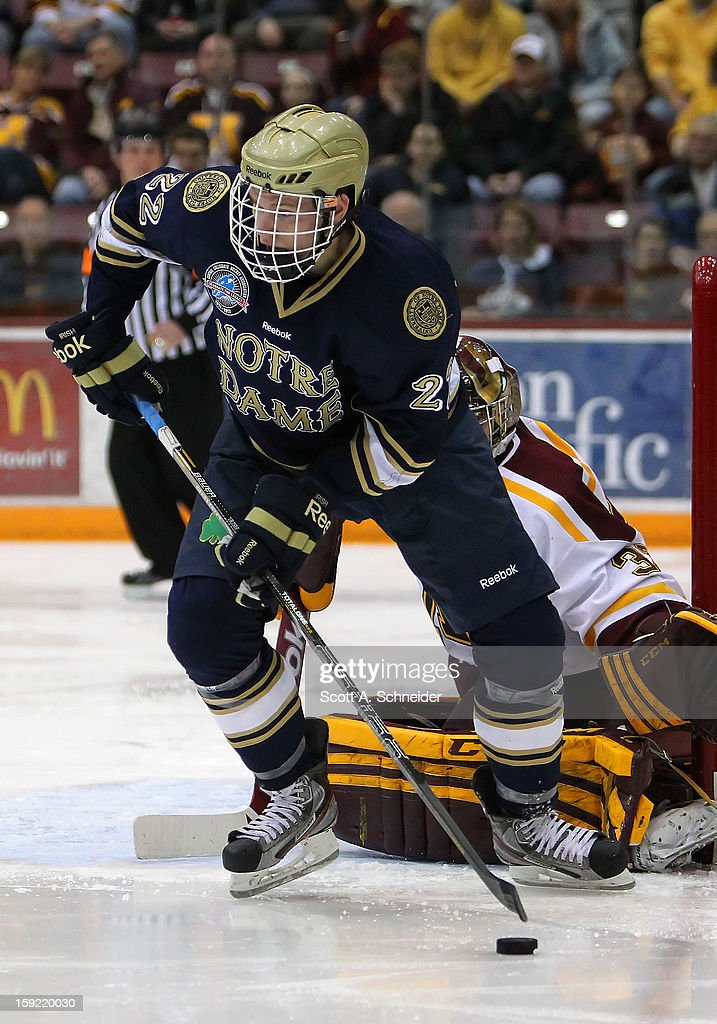 Mario Lucia #22 of the Notre Dame Fighting Irish carries the puck against the Minnesota Gophers January 8, 2013 at Mariucci Arena in Minneapolis, Minnesota.