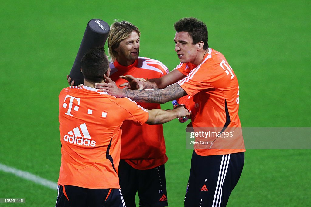 Mario Mandzukic, Anatoliy Tymoshchuk and Xherdan Shaqiri (R-L) fight fior fun during a Bayern Muenchen training session at the ASPIRE Academy for Sports Excellence on January 4, 2013 in Doha, Qatar.