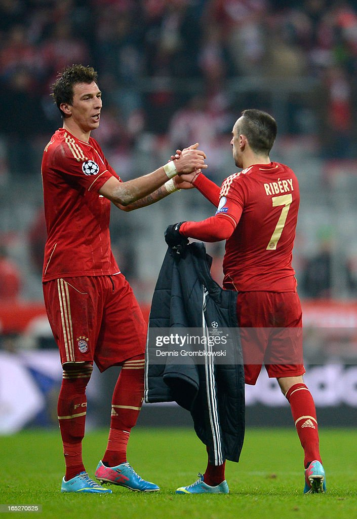 Mario Mandzukic and Franck Ribery of FC Bayern Muenchen celebrate victory after the UEFA Champions League quarter final first leg match between FC Bayern Muenchen and Juventus at Allianz Arena on April 2, 2013 in Munich, Germany.