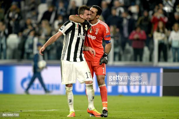 Mario Mandzukic and Gianluigi Buffon of Juventus celebrate at the end during the UEFA Champions League group D match between Juventus and Sporting CP...