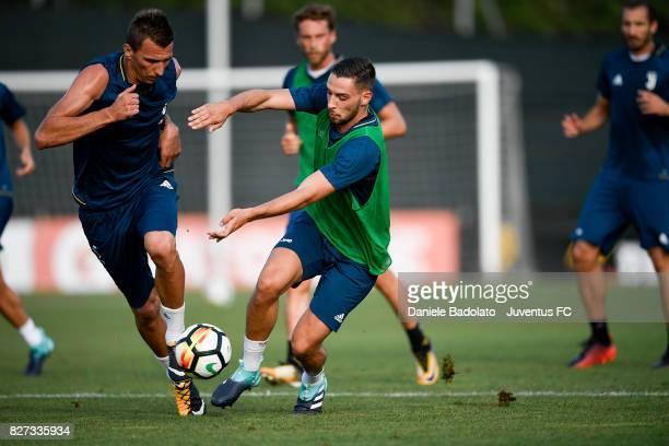 Mario Mandzukic and Mattia De Sciglio of Juventus during a training session on August 7 2017 in Vinovo Italy