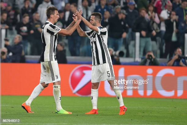 Mario Mandzukic and Miralem Pjanic celebrate at the end of the UEFA Champions League group D match between Juventus FC and Sporting Clube de Portugal...