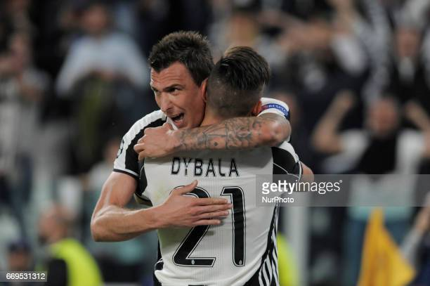 Mario Mandzukic and Paulo Dybala of Juventus players exult for the goal scored during the Uefa Champions League 20162017 match between FC Juventus...