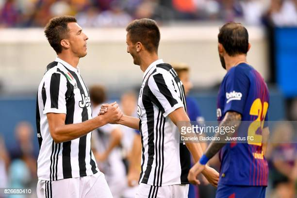 Mario Mandzukic and Rodrigo Bentancur of Juventus in action during the International Champions Cup match between Juventus and Barcelona at MetLife...