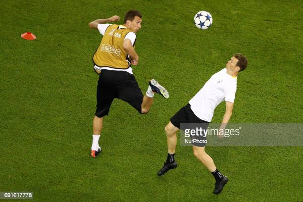 Mario Mandzukic and Stephen Lichtsteiner during a Juventus training session prior to the UEFA Champions League Final at National Stadium of Wales on...