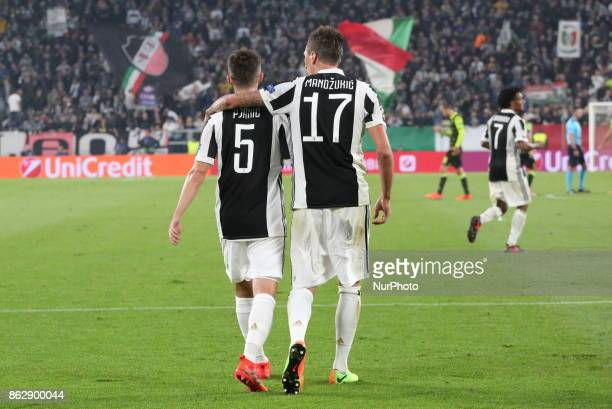 Mario Mandzukic celebrate after scoring with Miralem Pjanic during the UEFA Champions League football match between Juventus FC and Sporting CP at...