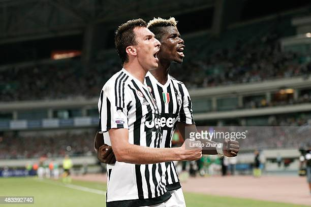 Mario Mandzukic celebrates a goal with his teammate Paul Labile Pogba of Juventus FC during the Italian Super Cup final football match between...