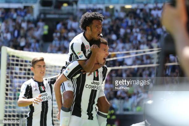 Mario Mandzukic celebrates after scoring during the Serie A football match between Juventus FC and FC Crotone at Juventus Stadium on may 21 2017 in...