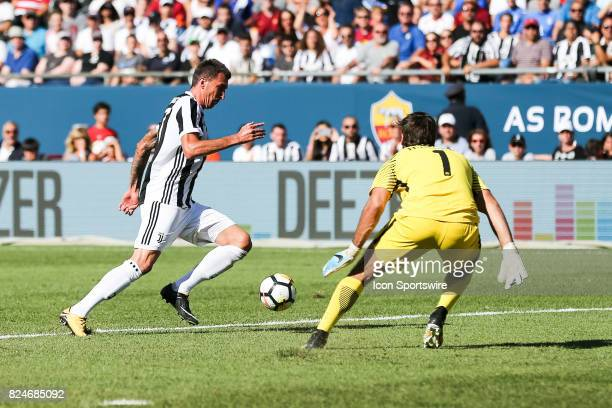 Mario Mandzukic goes round Alisson for Juventus' goal during the International Champions Cup match between Juventus and AS Roma on July 30 2017 at...