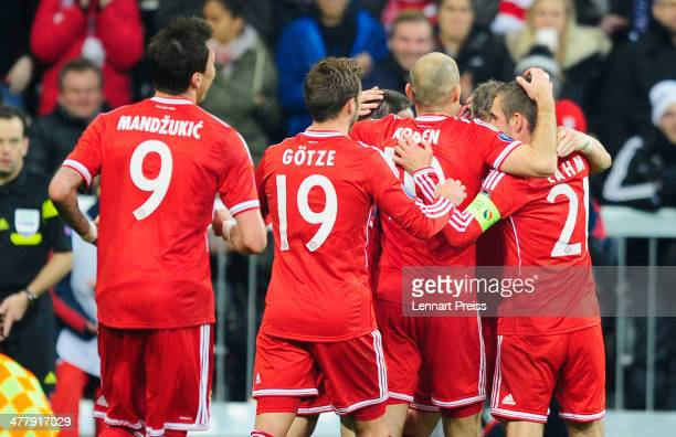 Mario Mandzukic Mario Goetze Arjen Robben Bastian Schweinsteiger and Philipp Lahm of Muenchen celebrate a goal during the UEFA Champions League Round...