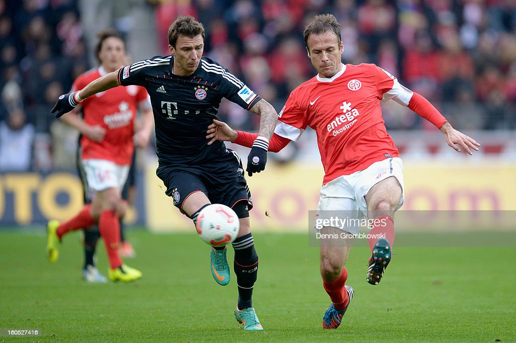 <a gi-track='captionPersonalityLinkClicked' href=/galleries/search?phrase=Mario+Mandzukic&family=editorial&specificpeople=4476149 ng-click='$event.stopPropagation()'>Mario Mandzukic</a> of Bayern and <a gi-track='captionPersonalityLinkClicked' href=/galleries/search?phrase=Nikolce+Noveski&family=editorial&specificpeople=649271 ng-click='$event.stopPropagation()'>Nikolce Noveski</a> of Mainz battle for the ball during the Bundesliga match between 1. FSV Mainz 05 and FC Bayern Muenchen at Coface Arena on February 2, 2013 in Mainz, Germany.