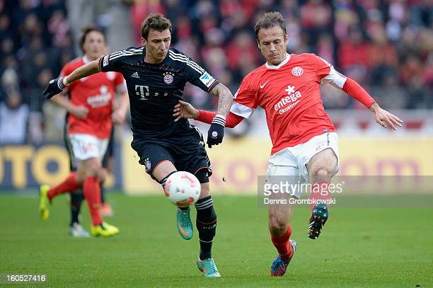 Mario Mandzukic of Bayern and Nikolce Noveski of Mainz battle for the ball during the Bundesliga match between 1 FSV Mainz 05 and FC Bayern Muenchen...