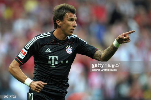 Mario Mandzukic of Bayern celebrates after scoring his team's first goal during the Bundesliga Supercup 2012 match between Bayern Muenchen and...
