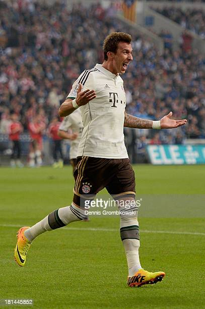 Mario Mandzukic of Bayern Muenchen celebrates after heading his team's second goal during the Bundesliga match between FC Schalke 04 and FC Bayern...
