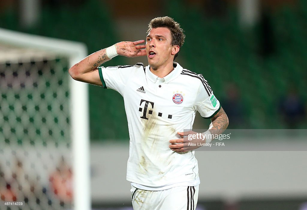 <a gi-track='captionPersonalityLinkClicked' href=/galleries/search?phrase=Mario+Mandzukic&family=editorial&specificpeople=4476149 ng-click='$event.stopPropagation()'>Mario Mandzukic</a> of Bayern Muenchen celebrates after scoring his goal during the FIFA Club World Cup Semi Final match between Guangzhou Evergrande FC and Bayern Muenchen at the Agadir Stadium on December 17, 2013 in Agadir, Morocco.