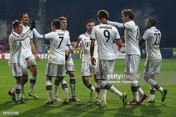 Mario Mandzukic of Bayern Muenchen celebrates scoring the opening goal with his team mates during the UEFA Champions League group D match between FC...