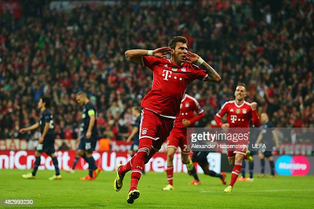 Mario Mandzukic of Bayern Muenchen celebrates scoring their first goal during the UEFA Champions League Quarter Final second leg match between FC...
