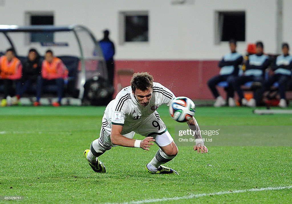 Mario Mandzukic of Bayern Muenchen scores his side's second goal during the FIFA Club World Cup Semi Final match between Guangzhou Evergrande FC and Bayern Muenchen at Agadir Stadium on December 17, 2013 in Agadir, Morocco.