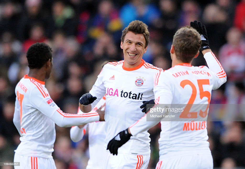 <a gi-track='captionPersonalityLinkClicked' href=/galleries/search?phrase=Mario+Mandzukic&family=editorial&specificpeople=4476149 ng-click='$event.stopPropagation()'>Mario Mandzukic</a> (C) of Bayern Munich celebrates scoring the opening goal with team-mates <a gi-track='captionPersonalityLinkClicked' href=/galleries/search?phrase=David+Alaba&family=editorial&specificpeople=5494608 ng-click='$event.stopPropagation()'>David Alaba</a> (L) and <a gi-track='captionPersonalityLinkClicked' href=/galleries/search?phrase=Thomas+Mueller&family=editorial&specificpeople=5842906 ng-click='$event.stopPropagation()'>Thomas Mueller</a> (R) during the friendly match between FC Basel and Bayern Munich at Stadium St. Jakob on January 12, 2013 in Basel, Switzerland.