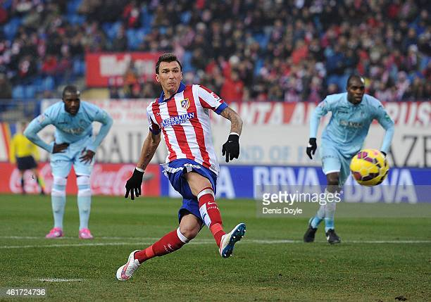 Mario Mandzukic of Club Atletico de Madrid scores from the penalty spot during the La Liga match between Club Atletico de Madrid and Granada CF at...