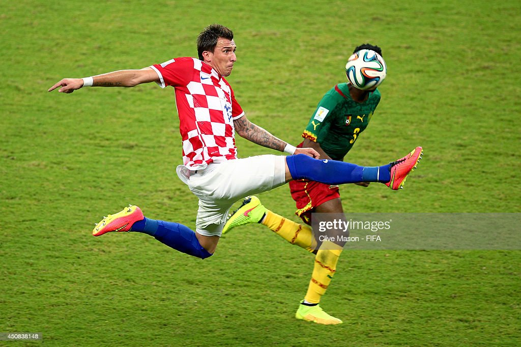 <a gi-track='captionPersonalityLinkClicked' href=/galleries/search?phrase=Mario+Mandzukic&family=editorial&specificpeople=4476149 ng-click='$event.stopPropagation()'>Mario Mandzukic</a> of Croatia and Nicolas N'Koulou of Cameroon compete for the ball during the 2014 FIFA World Cup Brazil Group A match between Cameroon and Croatia at Arena Amazonia on June 18, 2014 in Manaus, Brazil.